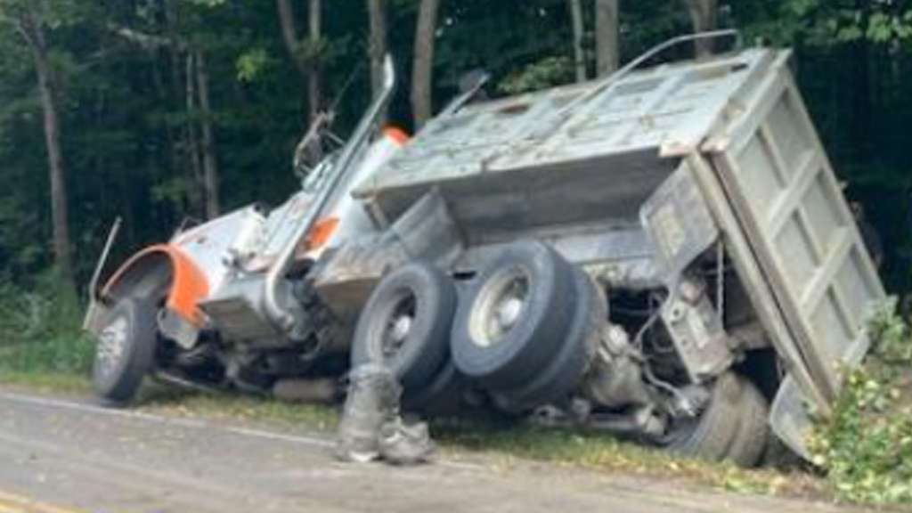 Police: Motorist avoids hitting stopped car by driving dump truck off roadway, into ditch in NH